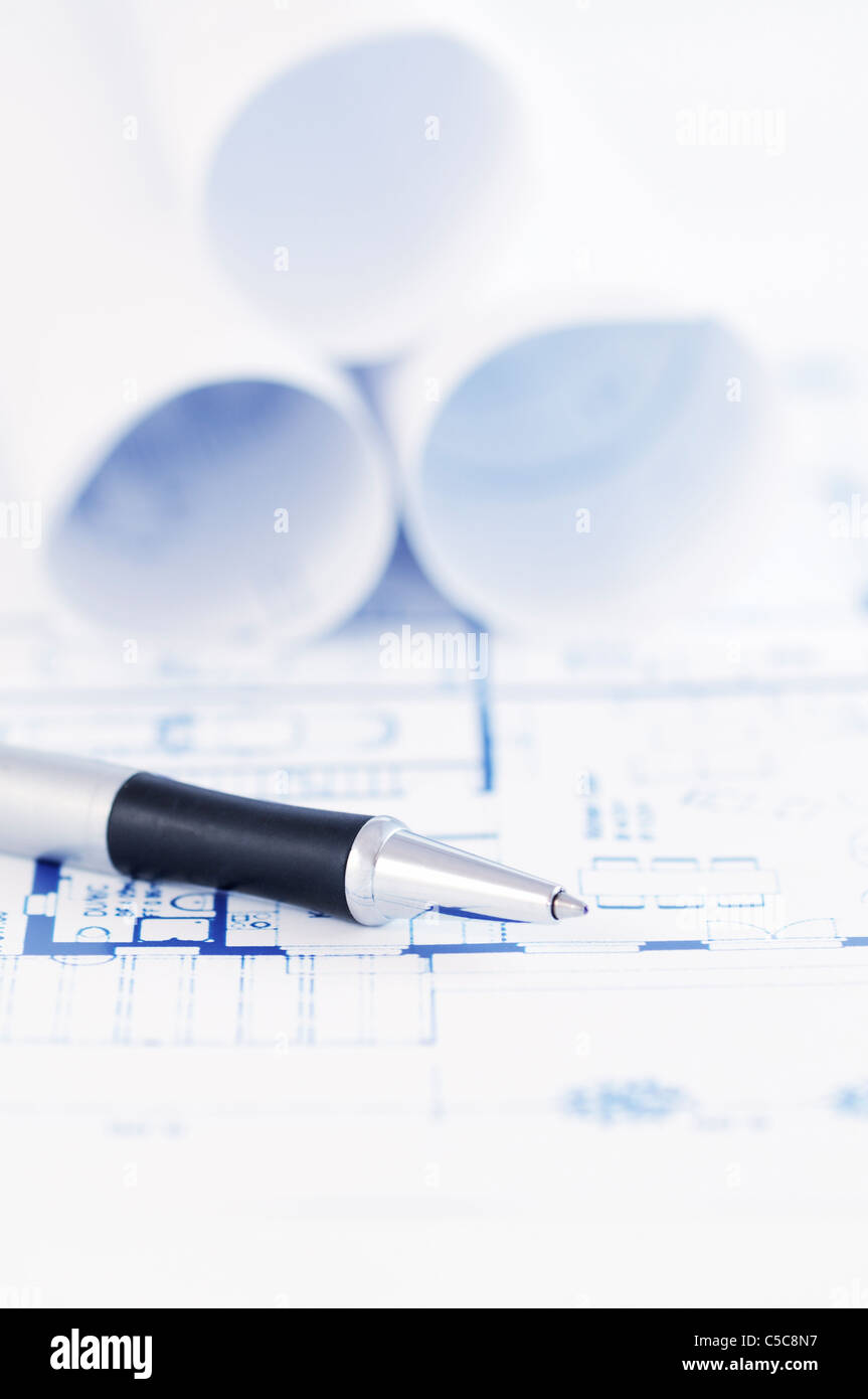 Silver pen over an architectural blueprint. - Stock Image