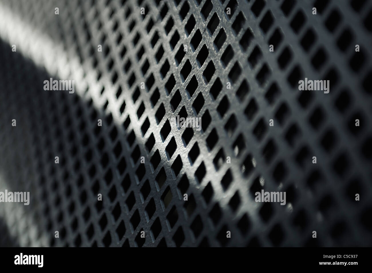 Old metal grid in perspective, short depth of field. - Stock Image