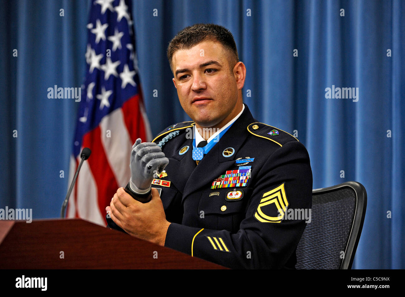 Medal of Honor recipient US Army Sgt. 1st. Class Leroy Petry touches his state-of-the-art prosthesis which replaced - Stock Image