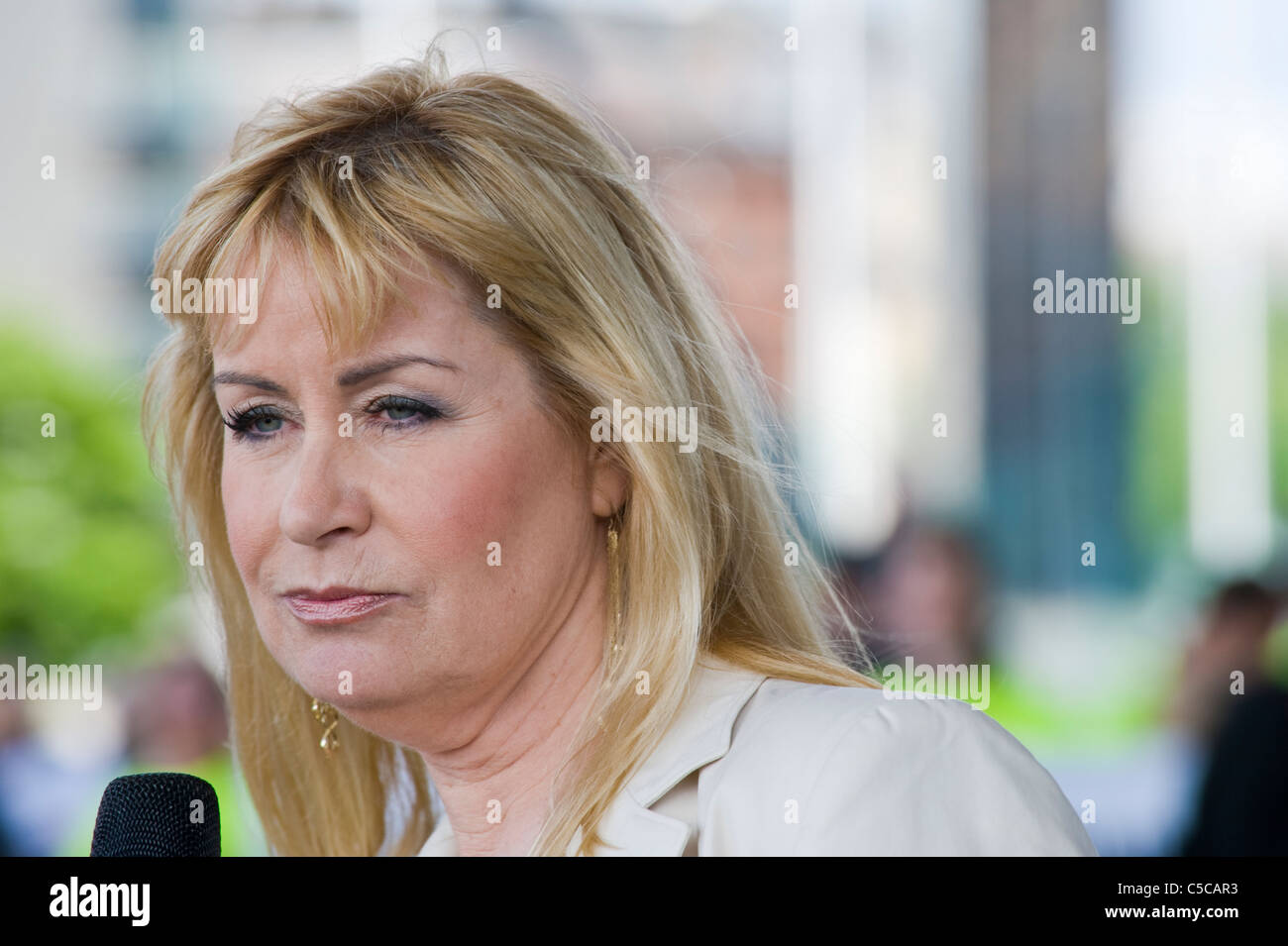 Sian Lloyd TV personality speaking at protest rally against proposed windfarms and infrastructure in the Welsh countryside - Stock Image