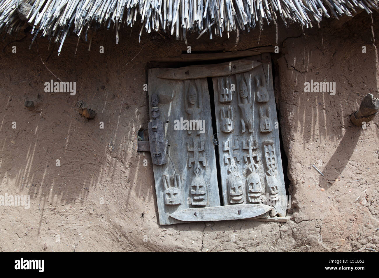 A dogon door on a granary hut in aye dogon Mali West Africa & A dogon door on a granary hut in aye dogon Mali West Africa Stock ...