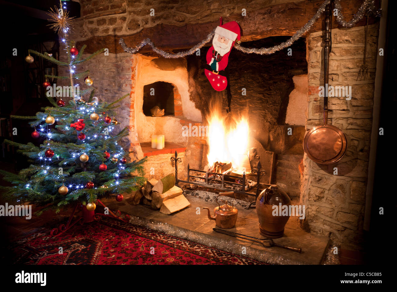 Inglenook Fireplace In Old House With High Blazing Log