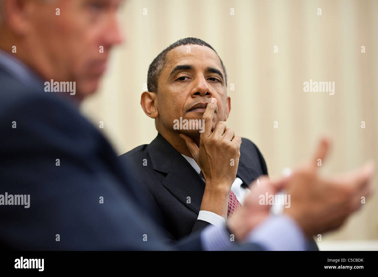 President Barack Obama listens as Vice President Joe Biden makes a point during a meeting with the Democratic leadership - Stock Image