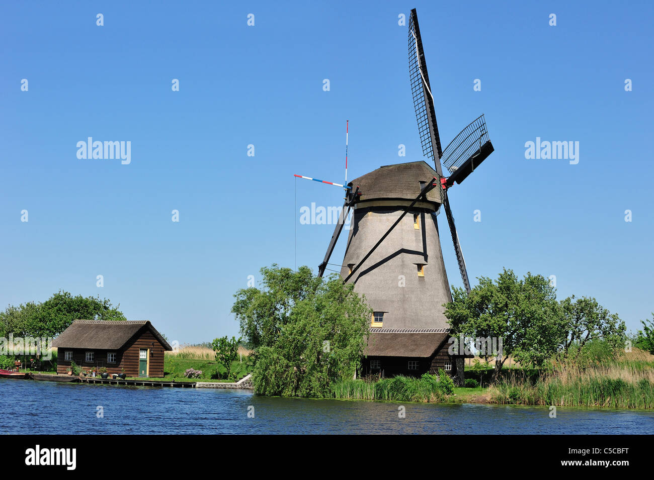Thatched polder windmill at Kinderdijk, a UNESCO World Heritage Site at South Holland, the Netherlands - Stock Image