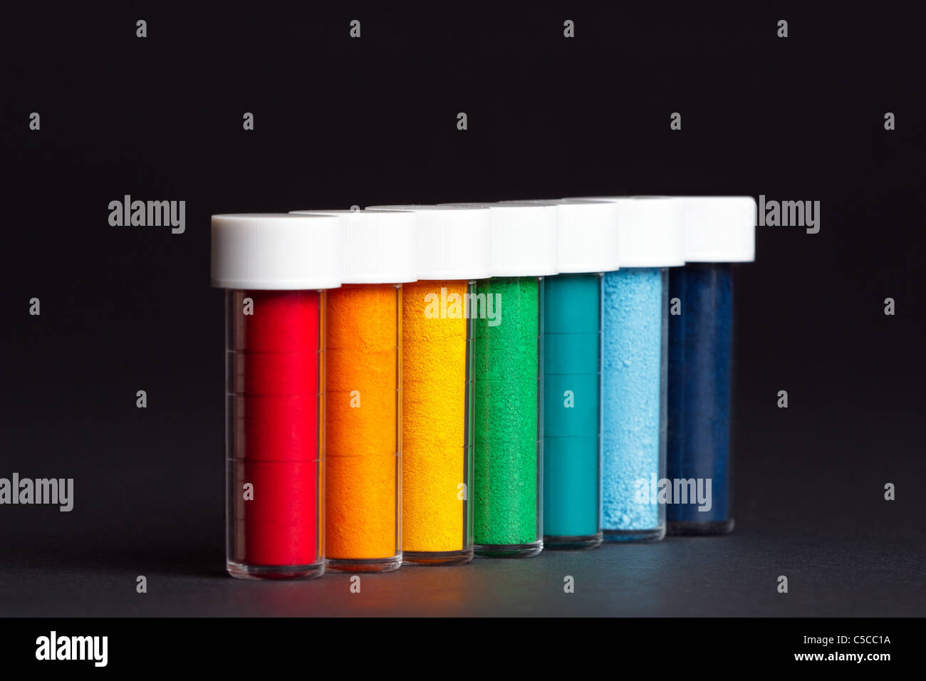 Vials of powdered food colouring - Stock Image