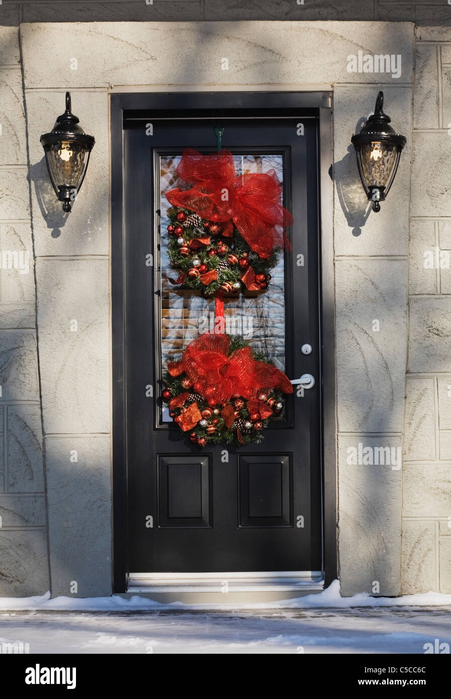 front entrance door on a residential home with christmas decorations in winter quebec canada