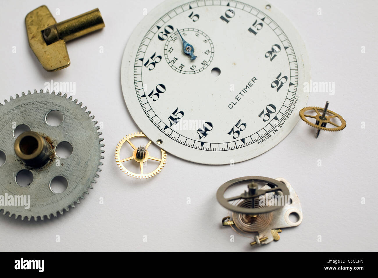 Clock parts sit on a white background. - Stock Image