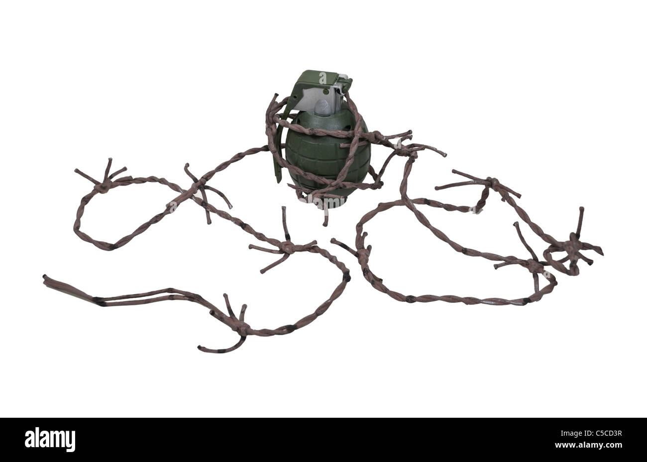 Green retro military grenade for blowing up things wrapped in barbed wire - path included - Stock Image