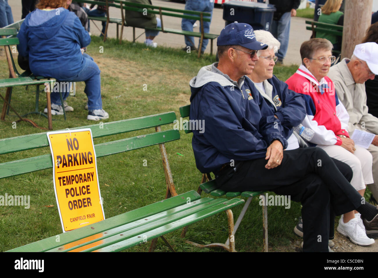 No Parking sign on a park bench. Canfield Fair. Mahoning County Fair. Canfield, Ohio, USA. No Parking - Temporary - Stock Image