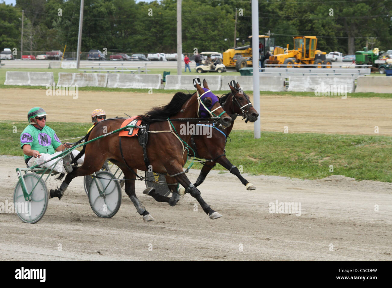 Harness Racing. Horse Racing. Canfield Fair. Mahoning County Fair. Canfield, Ohio, USA. Horses are in step. - Stock Image