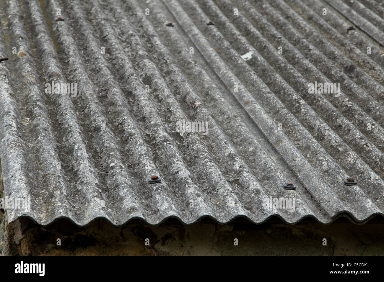Corrugated Asbestos Roofing On A Building In The U K Stock
