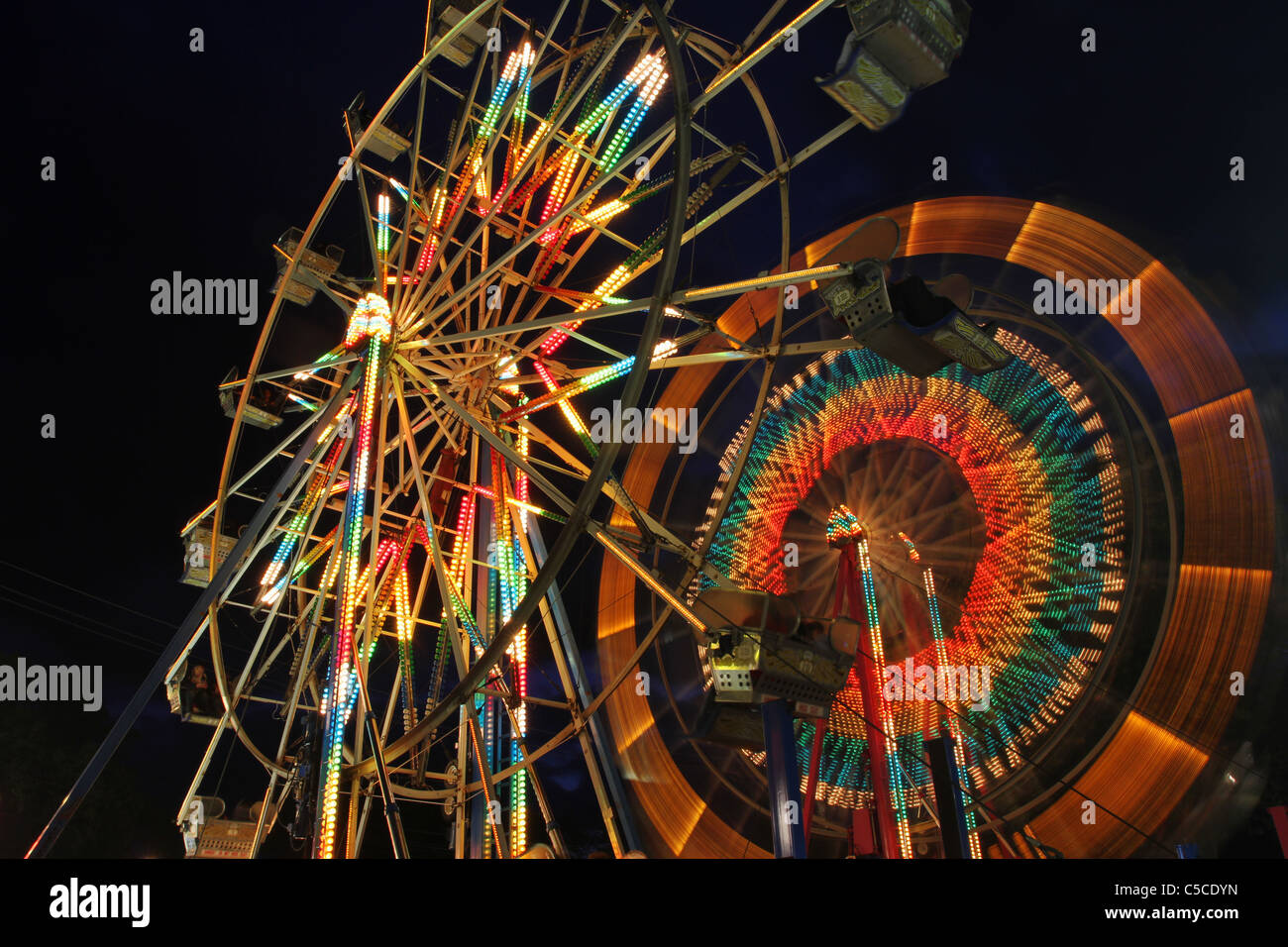 Ferris Wheels at night. Canfield Fair. Mahoning County Fair. Canfield, Ohio, USA. - Stock Image