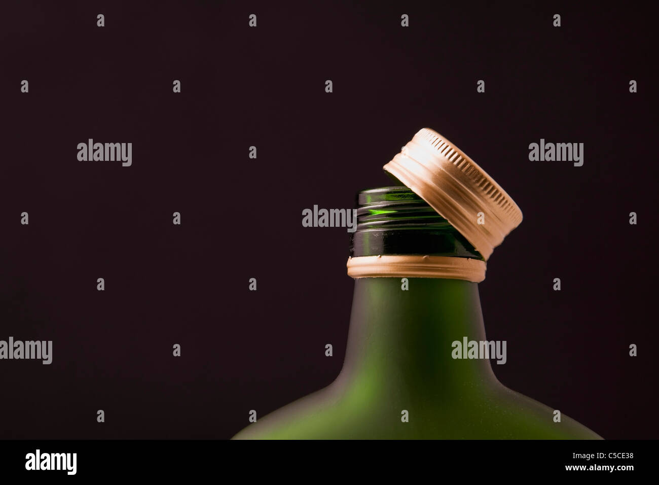 Close-Up Of A Liquor Bottle With The Cap Twisted Off Stock Photo