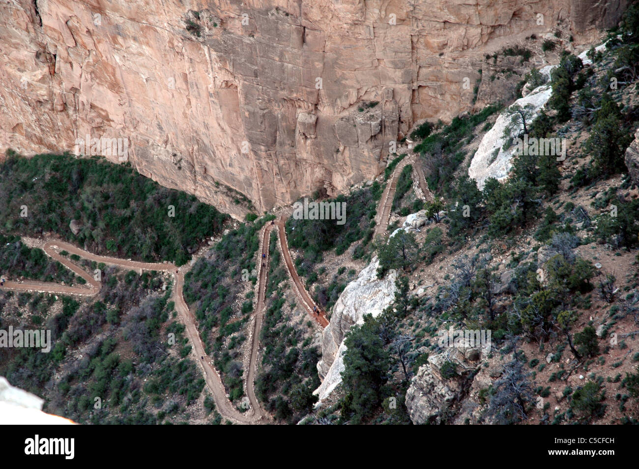 The Bright Angel Trail winds down the Grand Canyon using switchbacks that traverse the steep canyon walls. - Stock Image