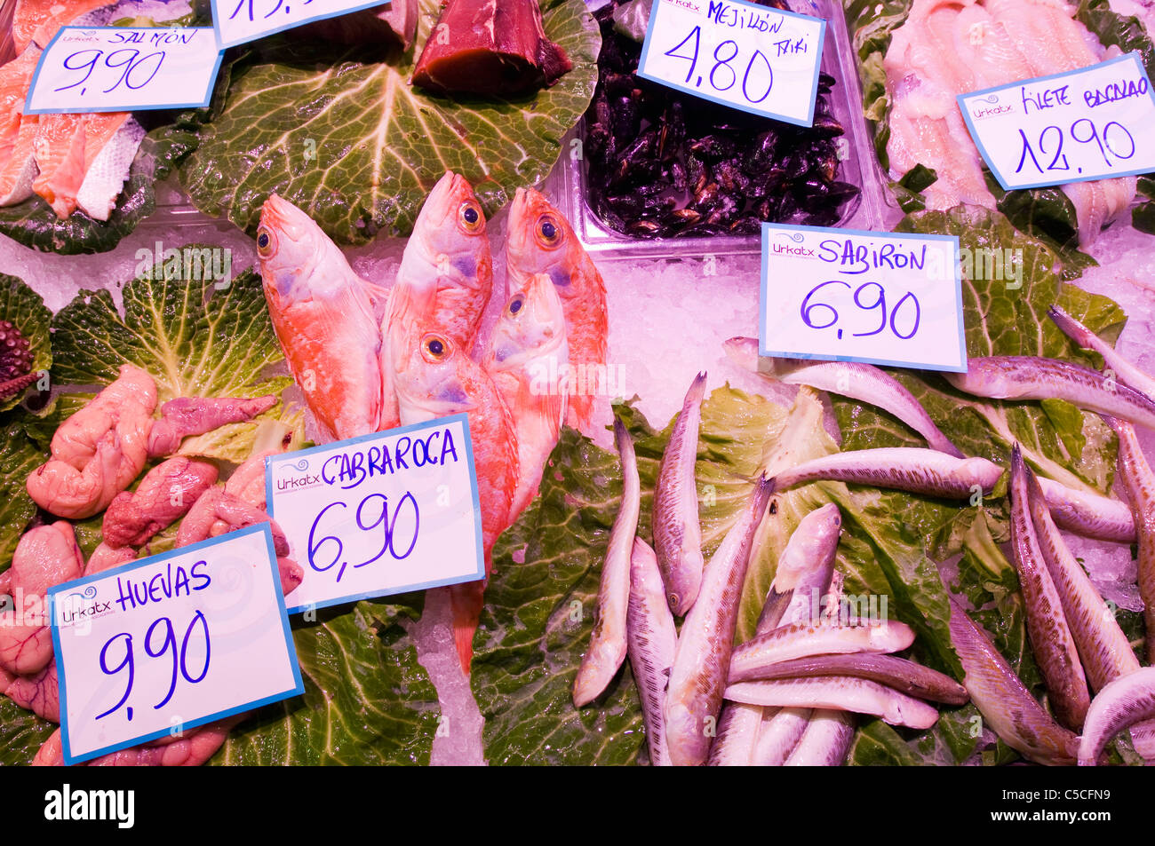 Fresh fish on ice on sales at a fishmonger - Stock Image