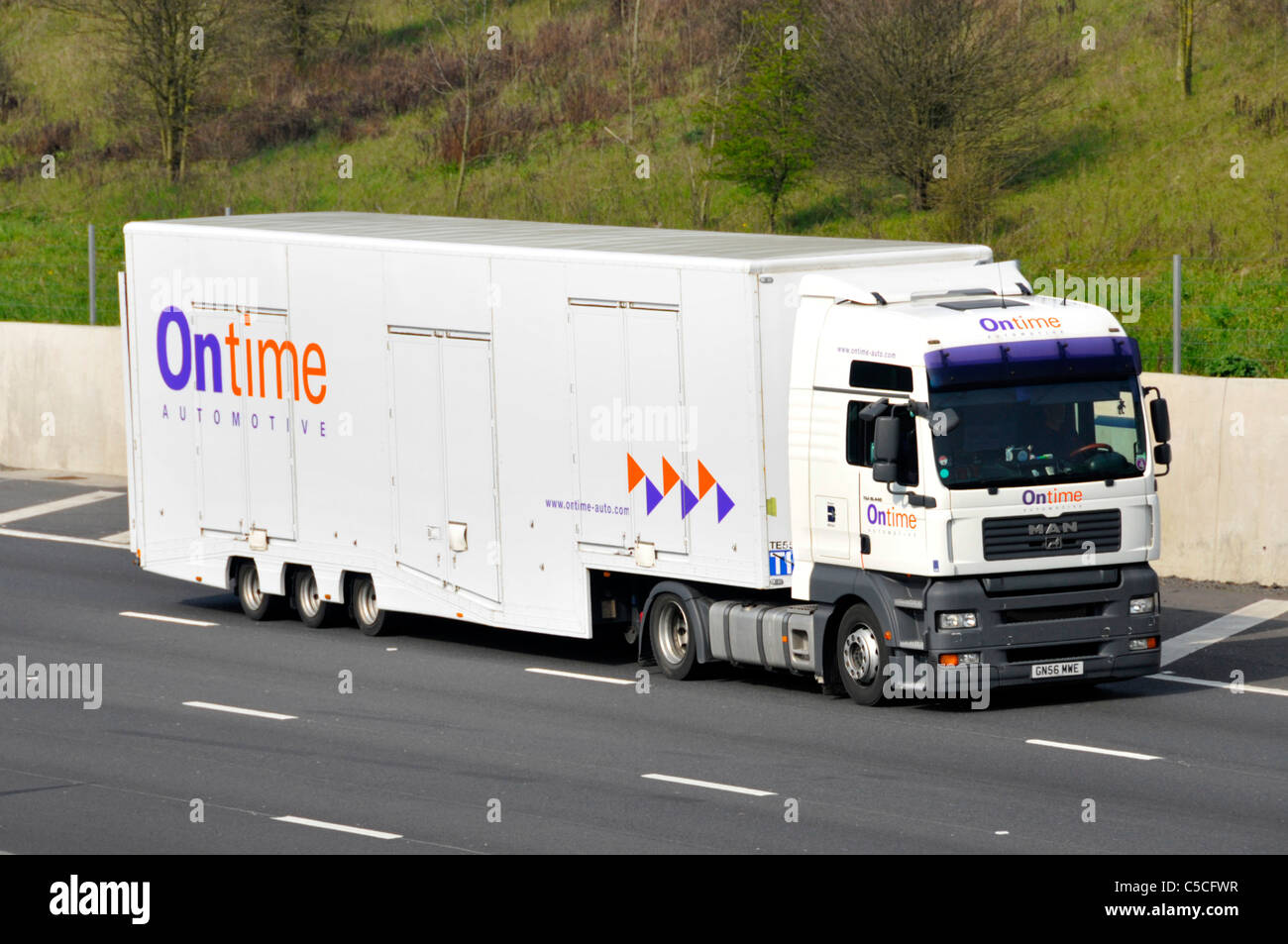 Front & side view of Ontime Automotive enclosed car delivery transport business hgv lorry truck & trailer - Stock Image