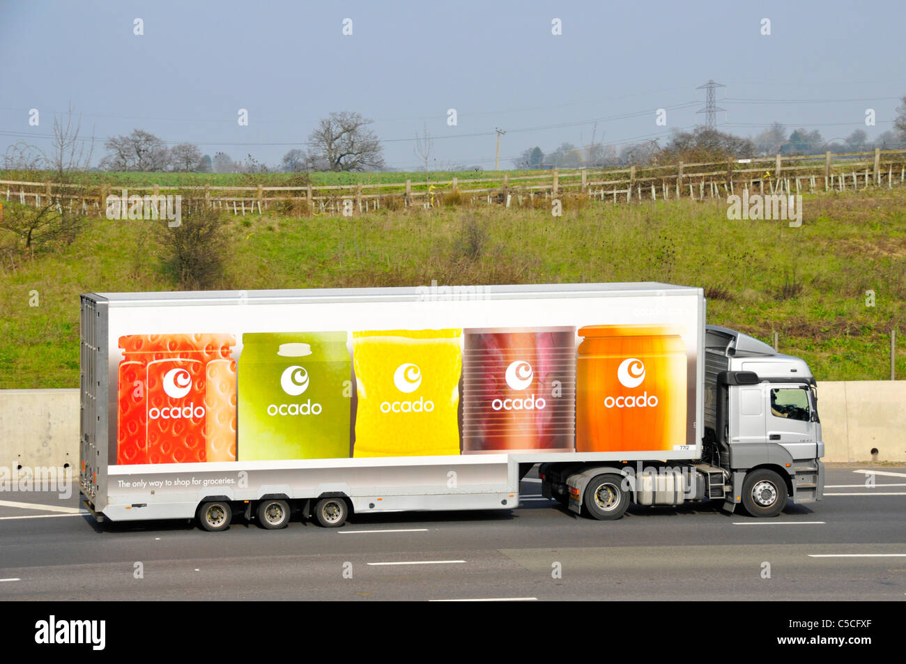 Ocado online internet shopping food grocery supply chain business side view hgv delivery lorry truck & articulated - Stock Image
