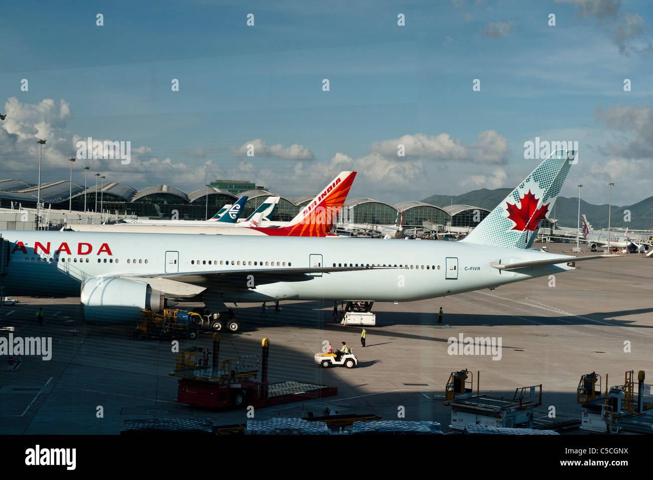 Hong Kong International Airport. Afternoon at Chek lap Kok, Hong Kong International Airport. With Air Canada and - Stock Image