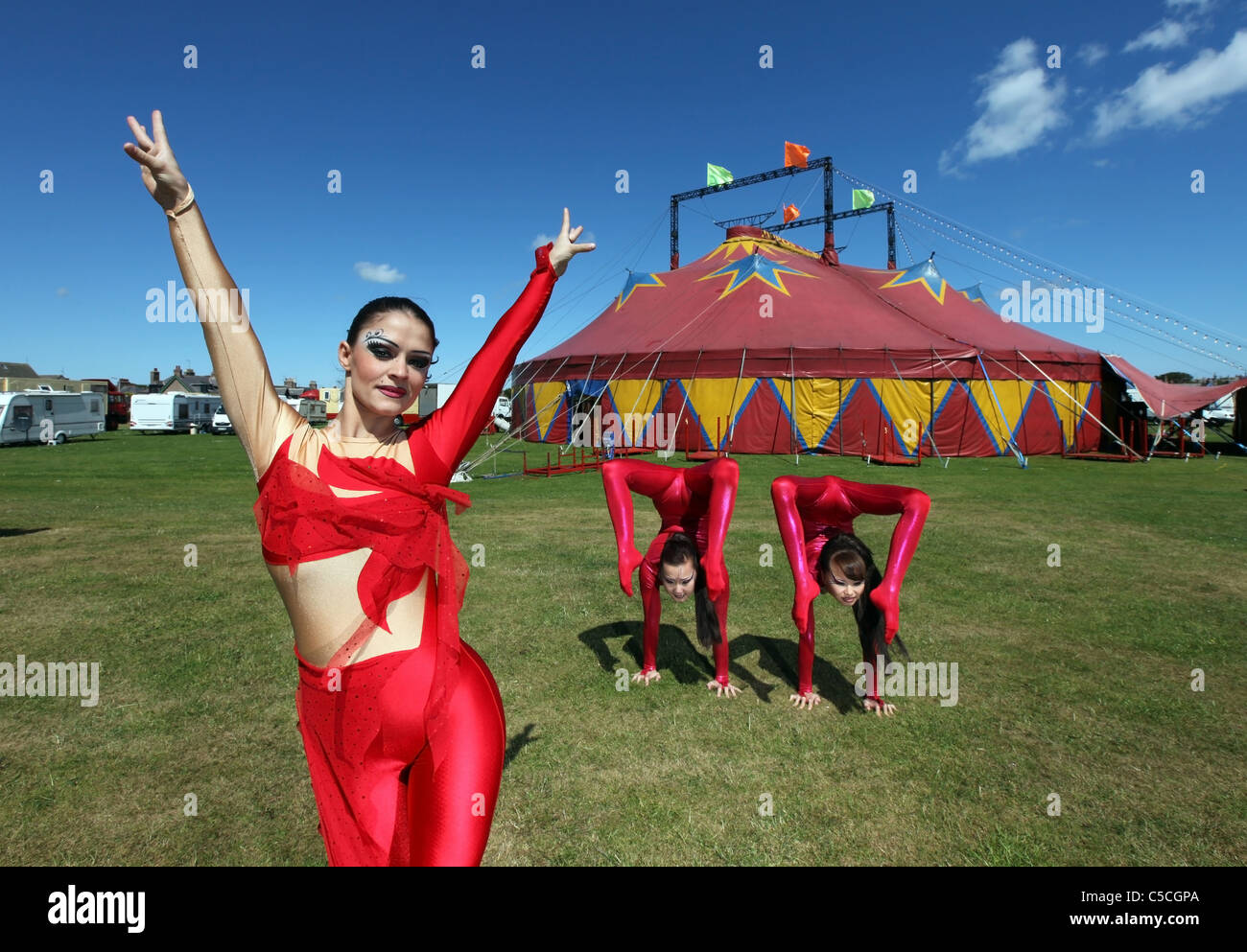 Female performers outside Zippos circus tent at a performance in the UK Stock Photo