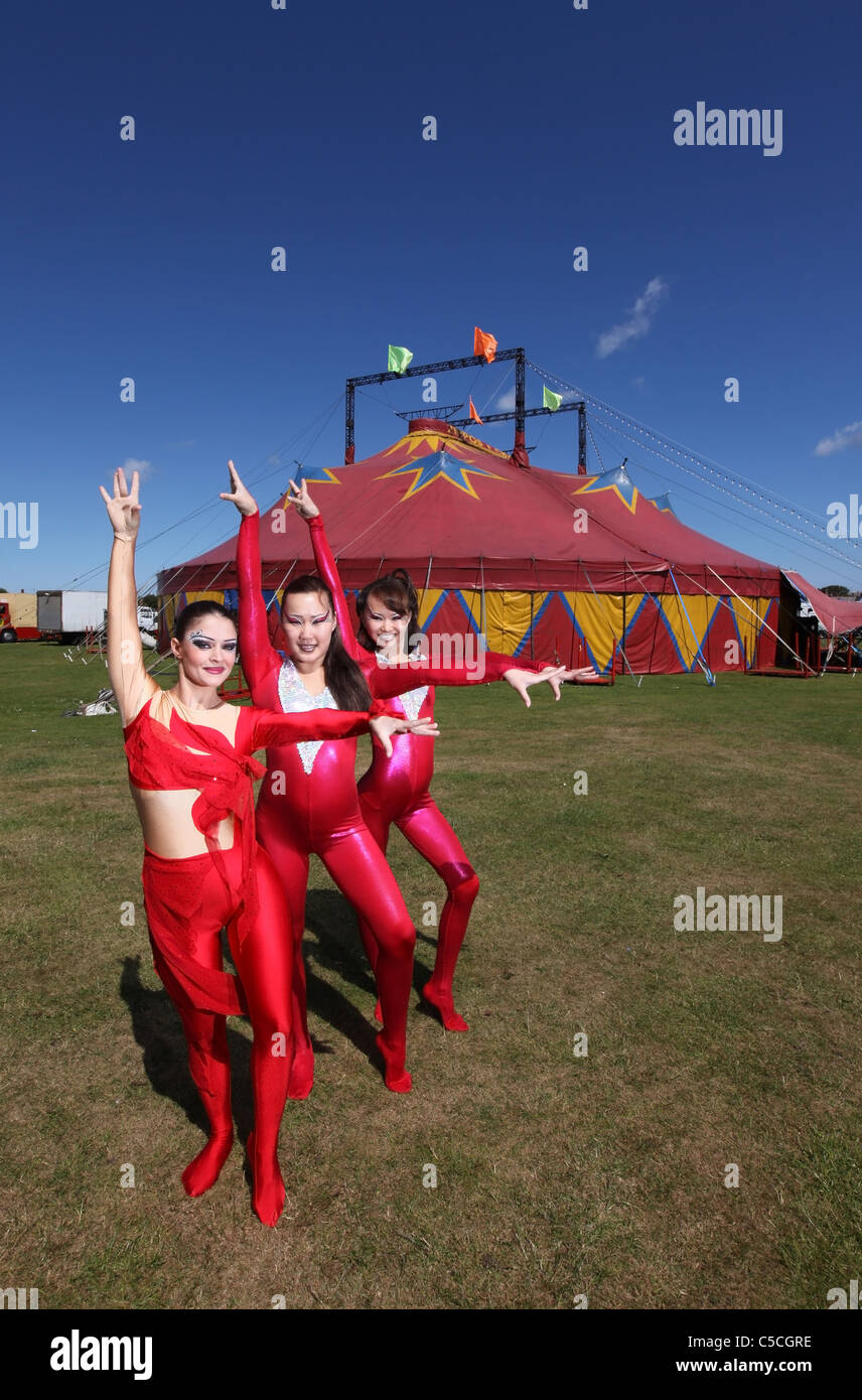 Female performers outside Zippos circus tent at a performance in the UK - Stock Image