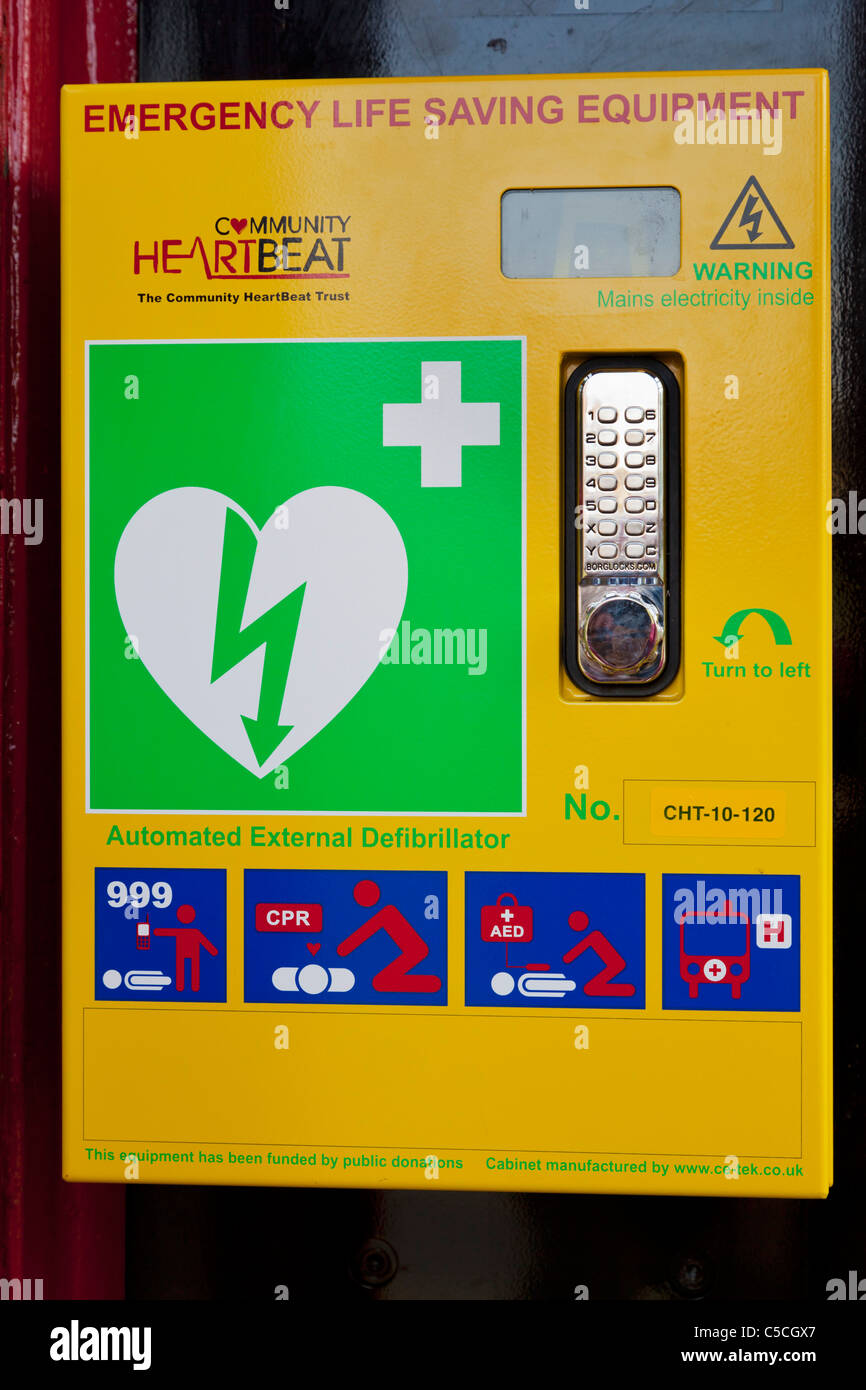 Defibrillator in a disused telephone kiosk Lower Slaughter village cotswolds England UK GB EU Europe - Stock Image