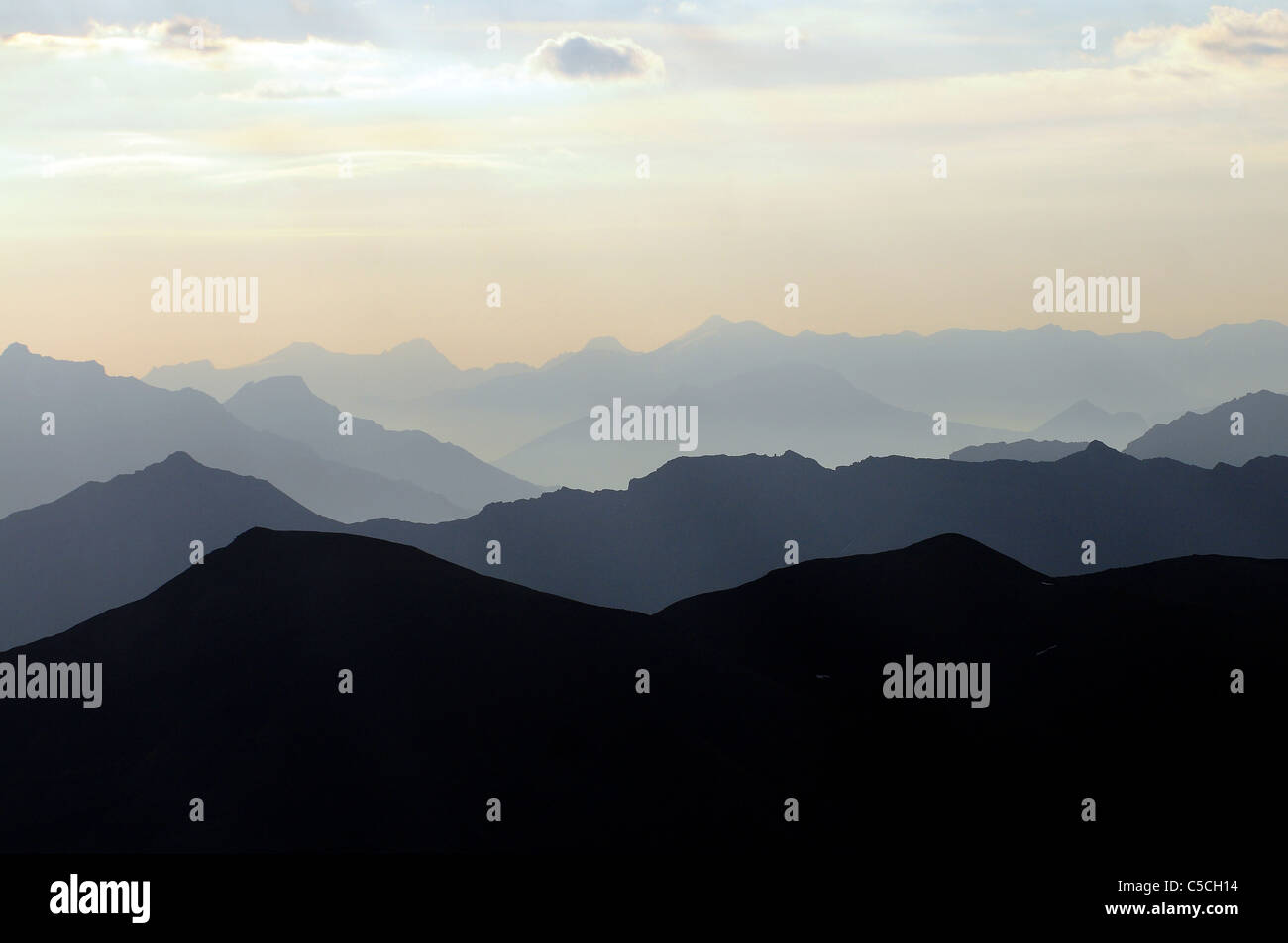 The view from the top of Pic Blanc in the ski resort of Alpe d'Huez in the French Alps during the summer. - Stock Image