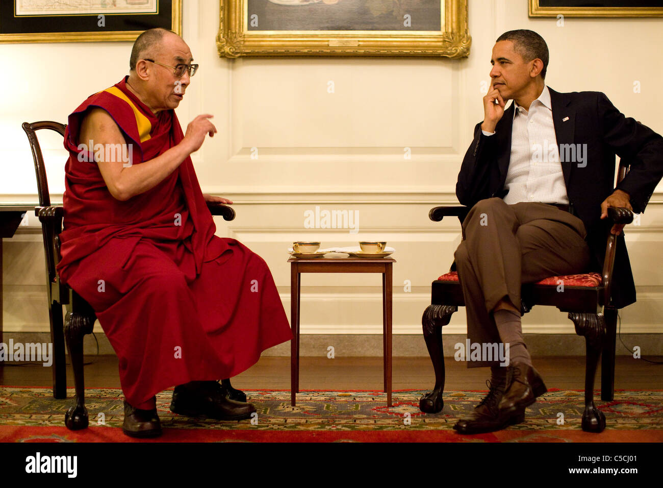 President Barack Obama meets with His Holiness the XIV Dalai Lama in the Map Room of the White House, Saturday, - Stock Image