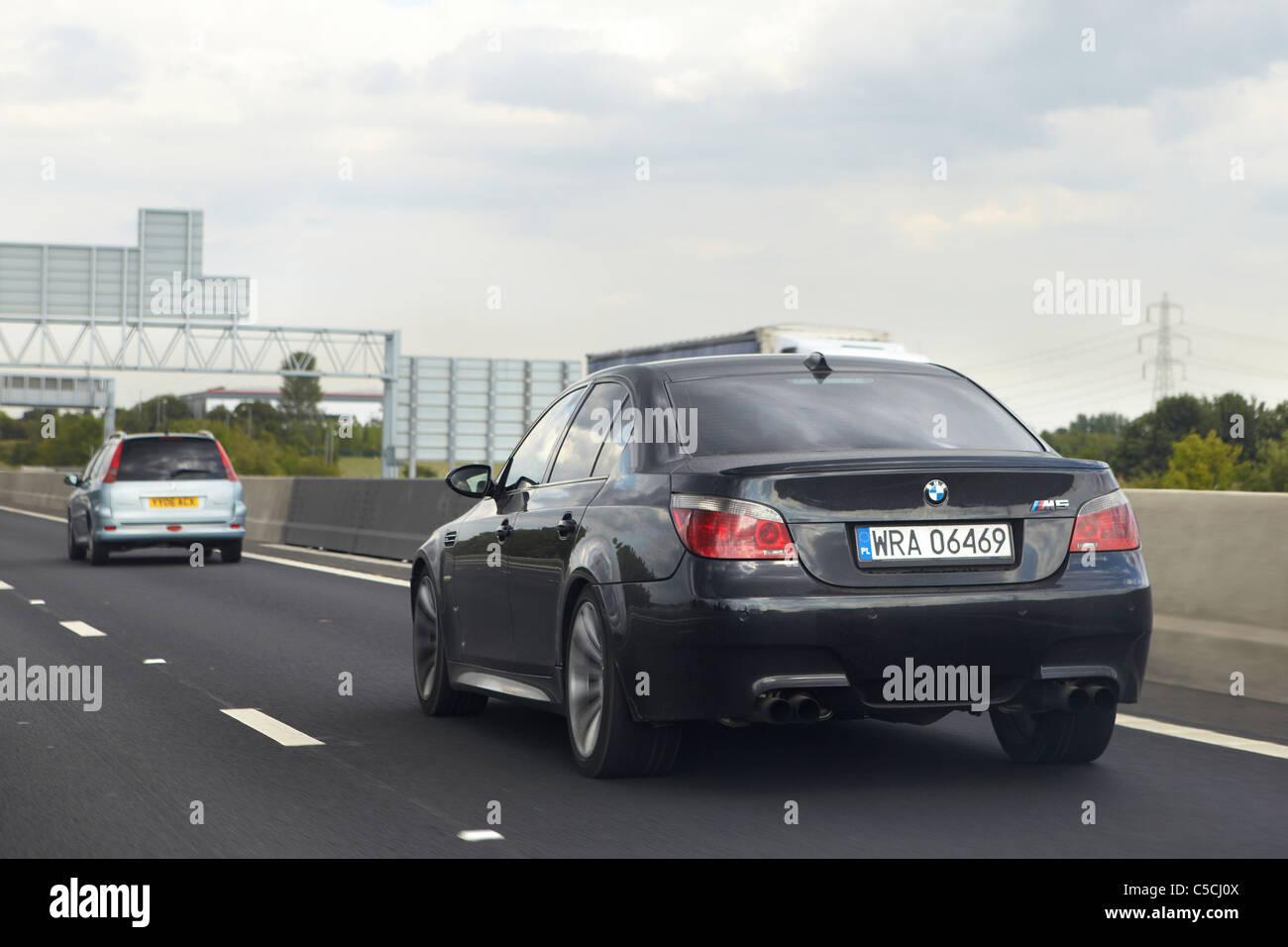 Black Bmw M5 E60 On Motorway Uk Stock Photo Alamy