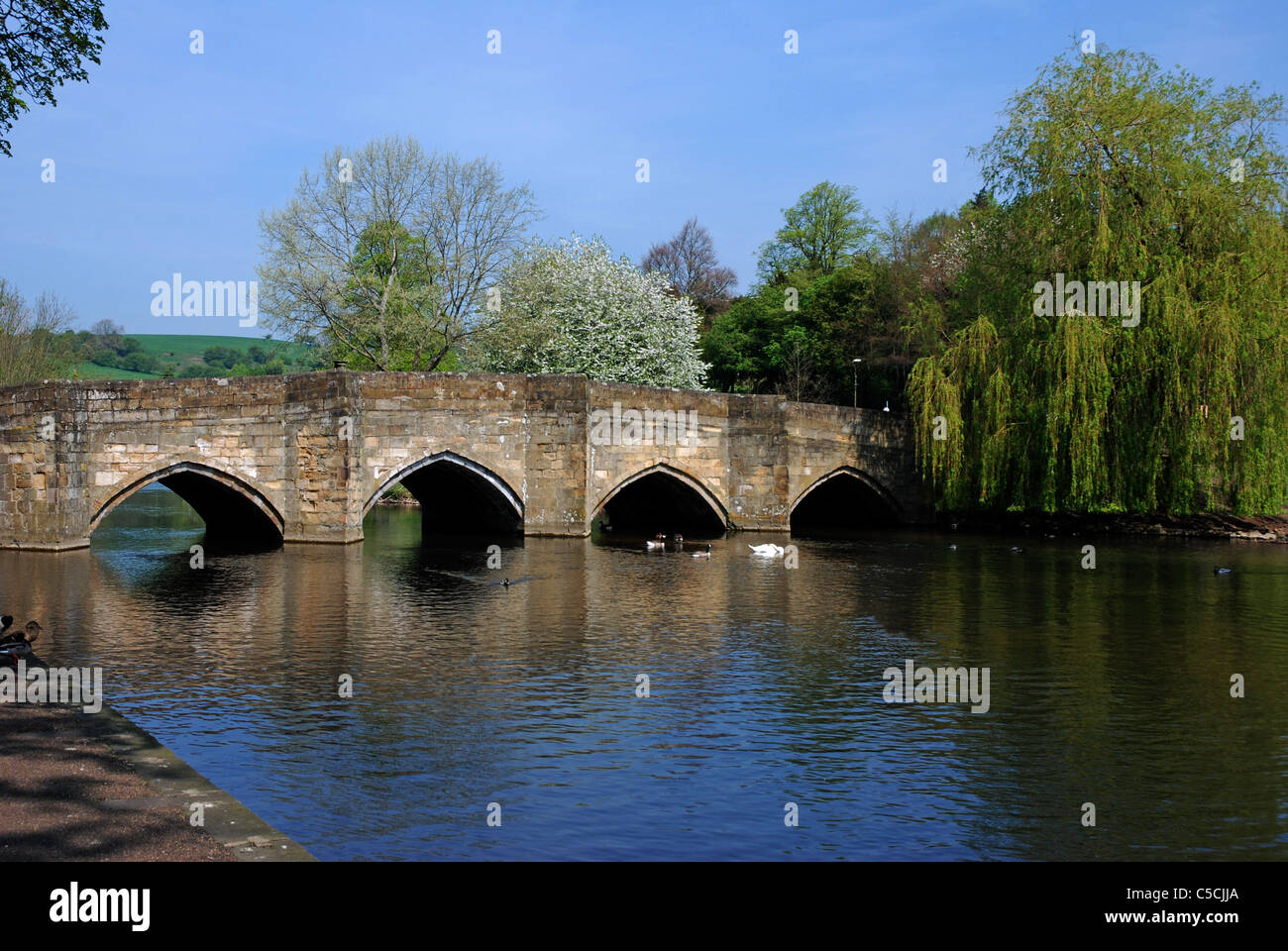 River Wye flowing through Bakewell town Derbyshire England - Stock Image
