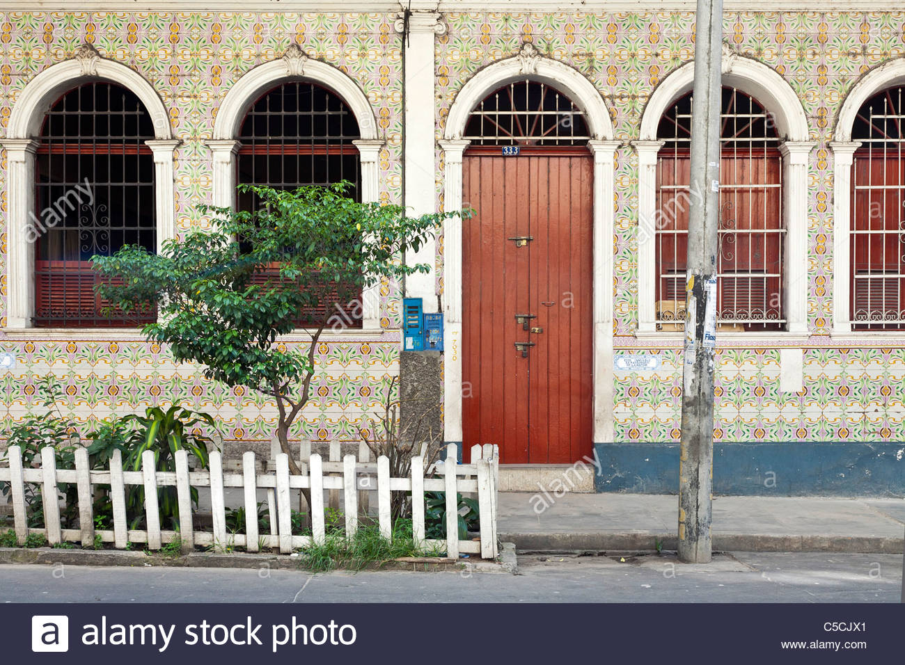 A building in central Iquitos covered in handmade Azulejos tiles imported from Portugal, Iquitos, Loreto, Peru - Stock Image