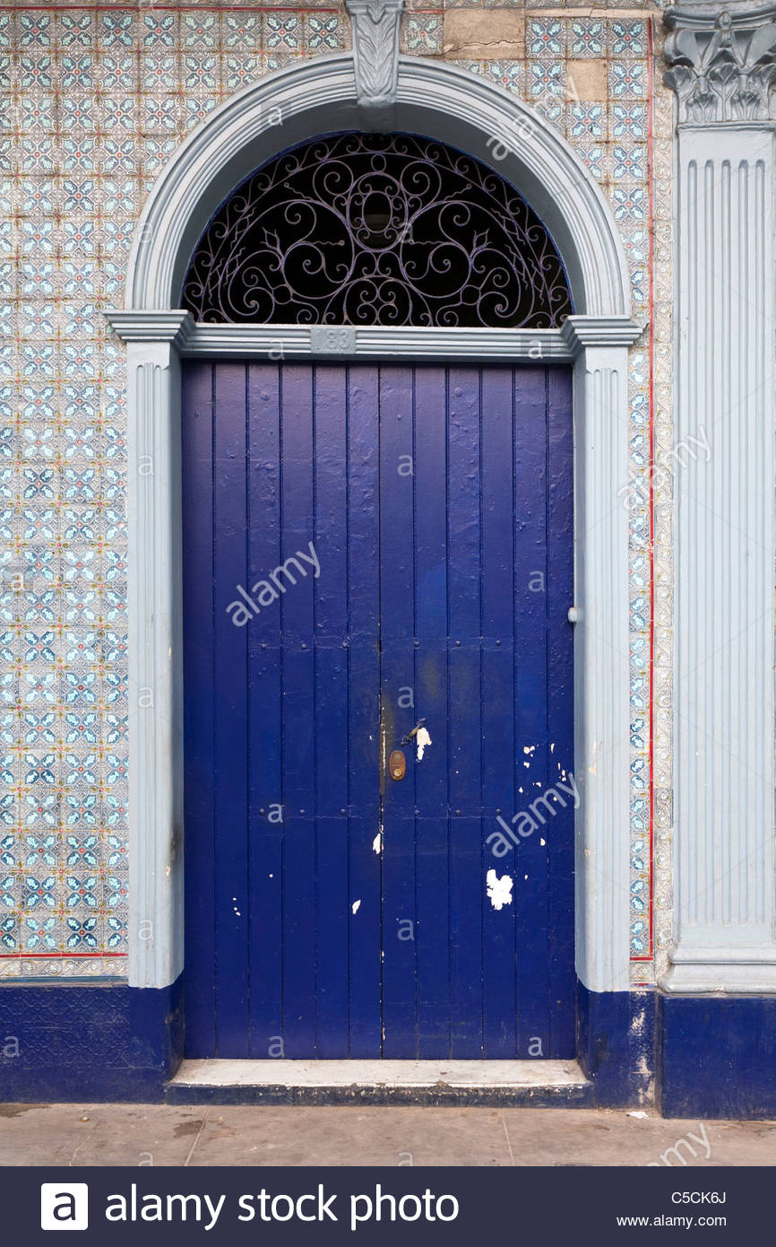 Blue door on a colonial building covered in Portuguese Azulejos tiles, Iquitos, Loreto, Peru - Stock Image