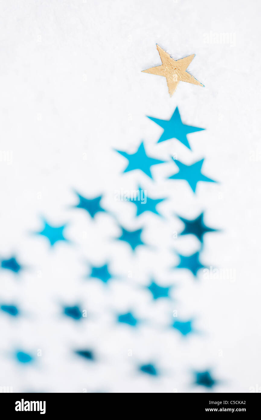 Shooting stars on snow pattern - Stock Image