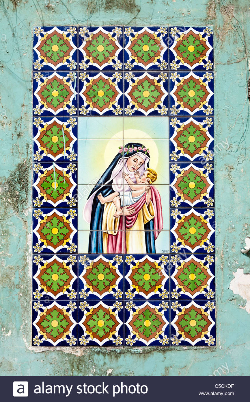 Hand-painted Azulejos Tiles depicting religious scenes in an abandoned building in Iquitos, Loreto, Peru - Stock Image