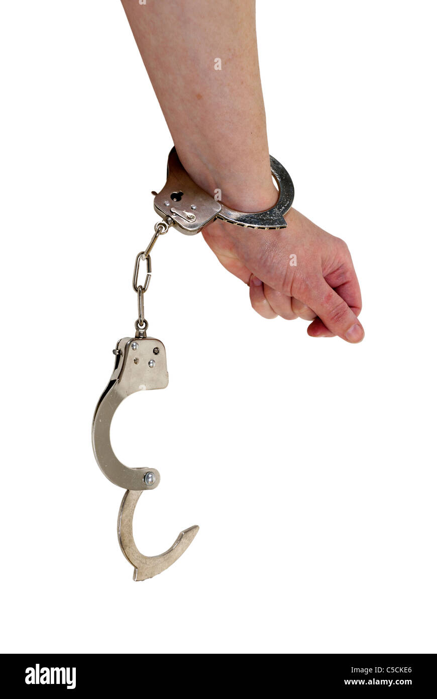 Breaking out of handcuffs made of metal with mechanical clasp - path included - Stock Image