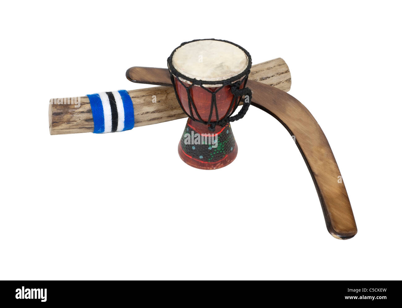 Djembe drum, rainstick and a boomerang made of wood - Stock Image