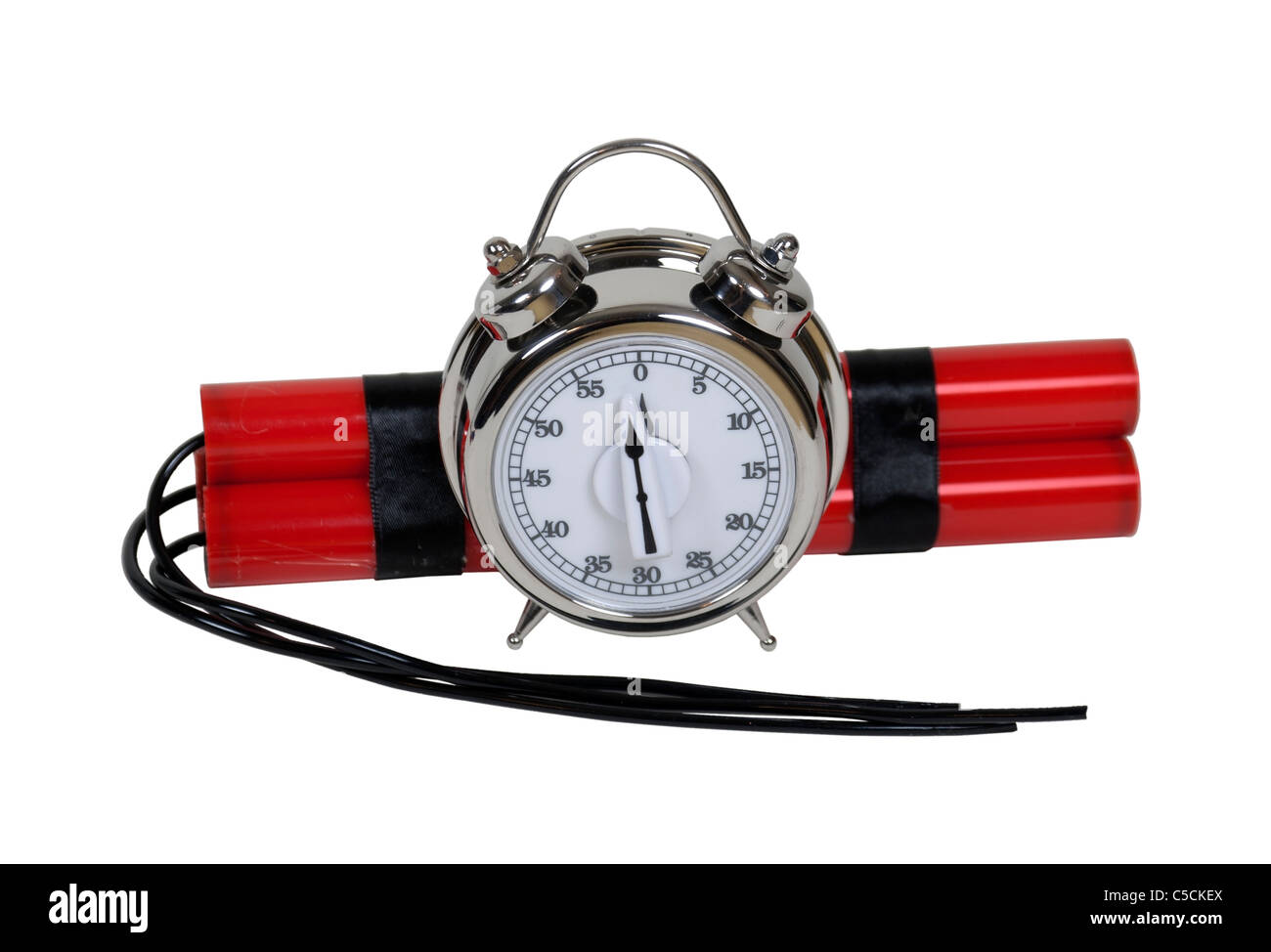 Bundle of red sticks of dynamite with long fuses with a timer alarm clock bomb that is only moments before zero - Stock Image