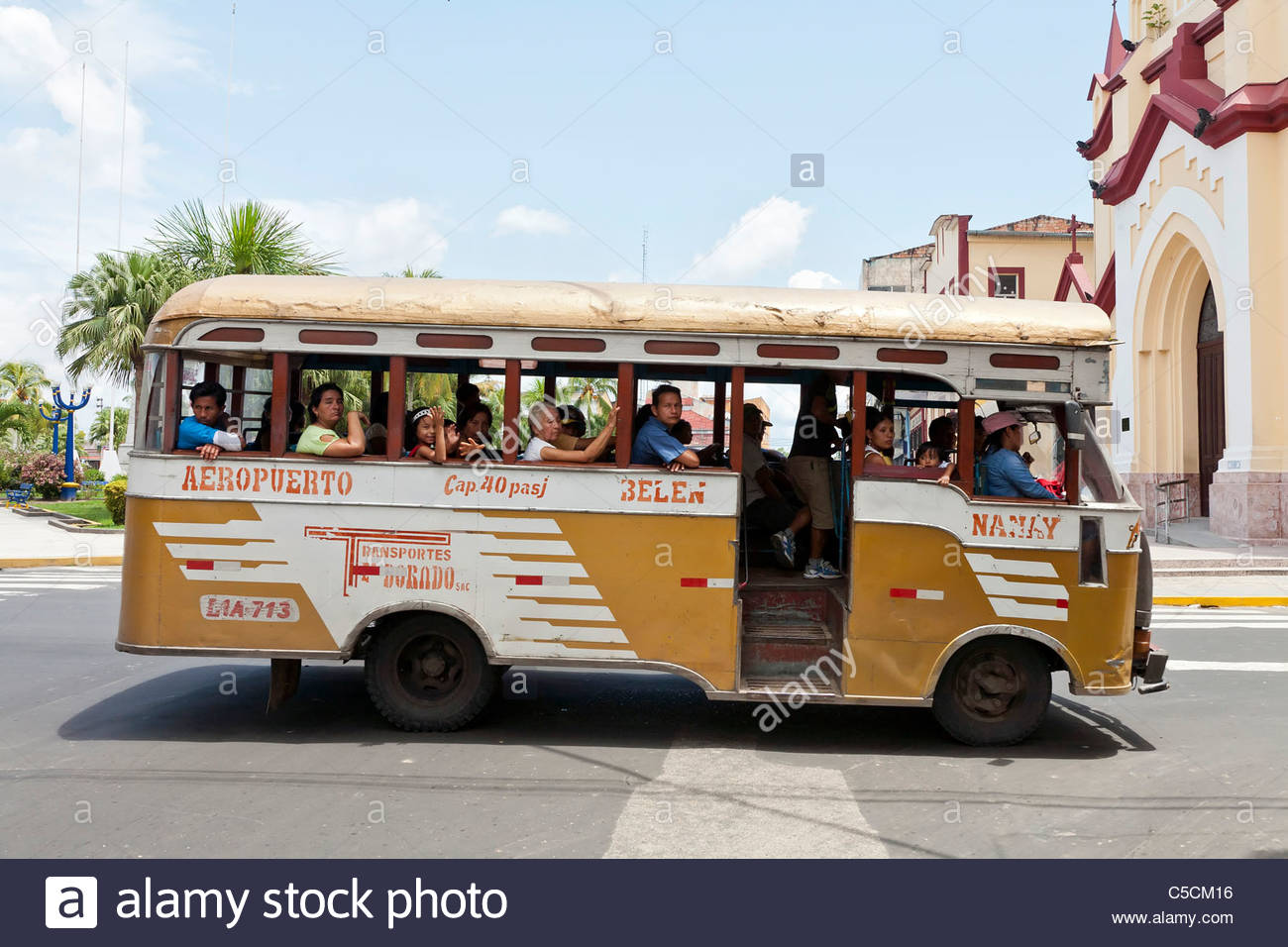 Small bus serving as public transportation in Iquitos, Loreto, Peru - Stock Image
