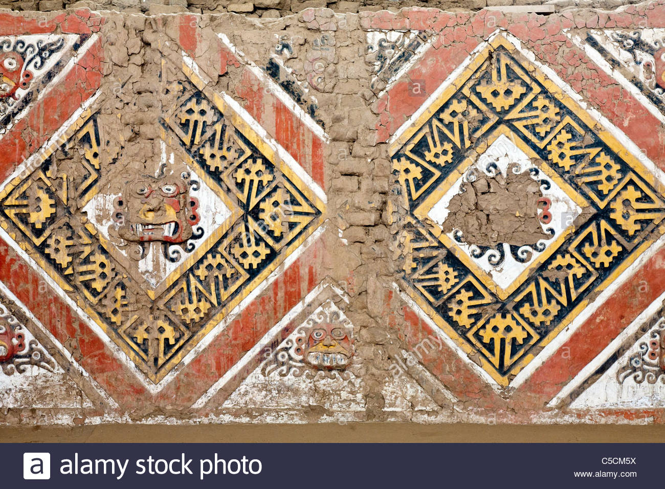 Brightly painted high relief friezes at the Moche temple site Huaca de la Luna, Trujillo, La Libertad, Peru - Stock Image