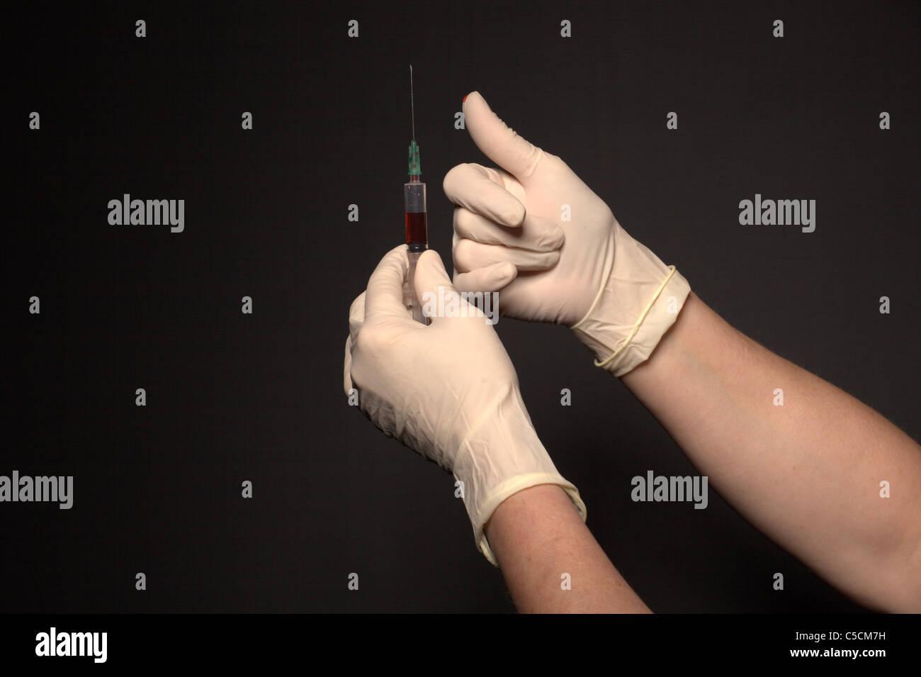 nurse preparing injection - Stock Image