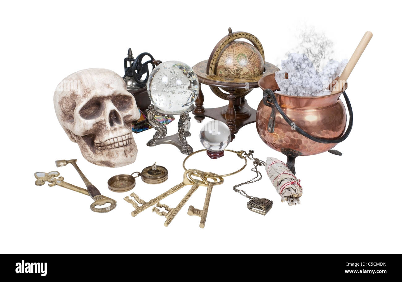 Skull, keys, copper pot, crystal ball and other Witch Desk Items - path included - Stock Image