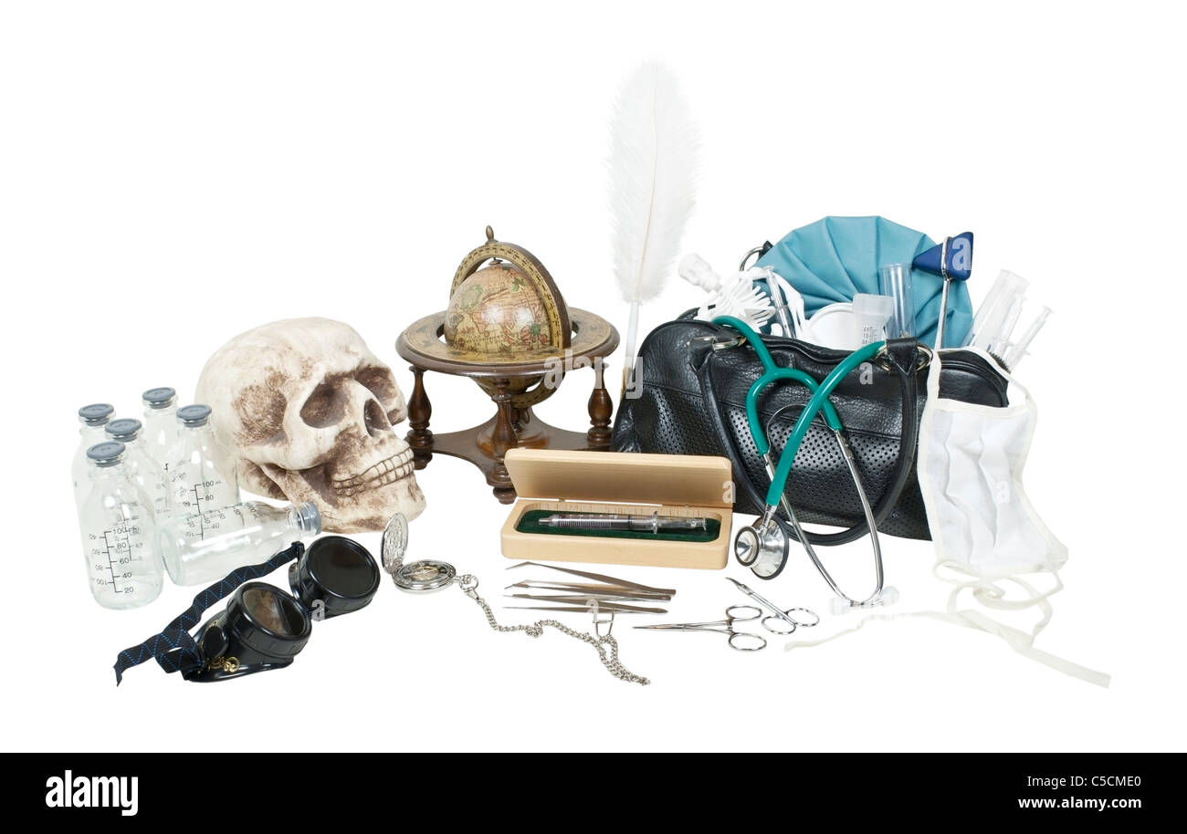 Vintage medical items on a desk including medical bag and skull - path included - Stock Image