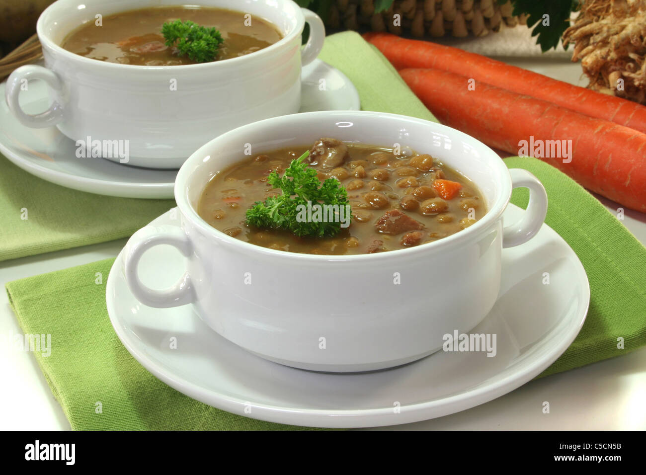Lentil stew with potatoes, carrots and parsley Stock Photo