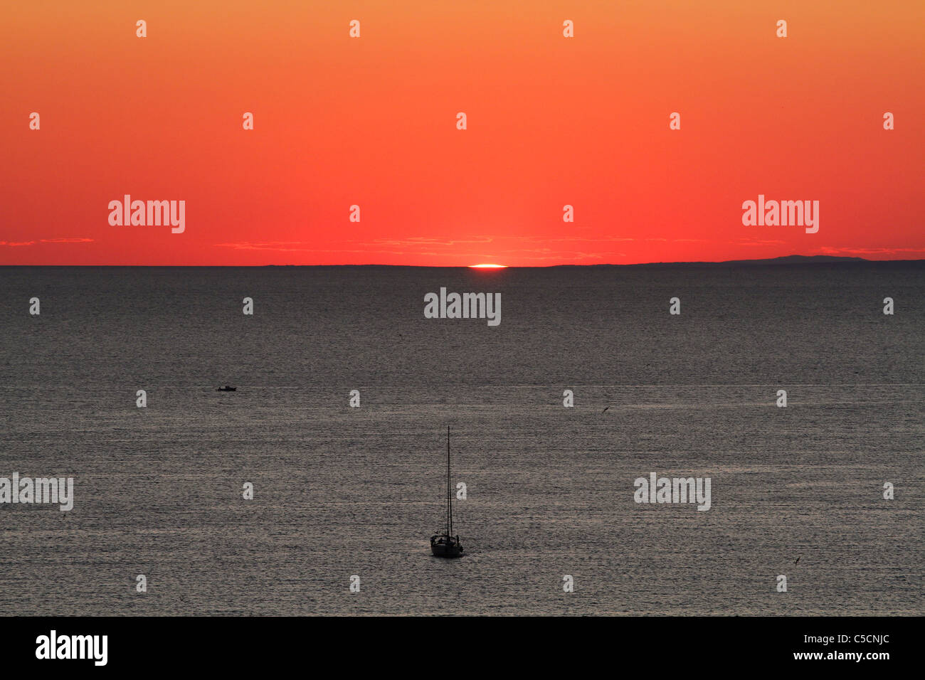 Sunset over the Adriatic Sea viewed from Zadar, Croatia - Stock Image