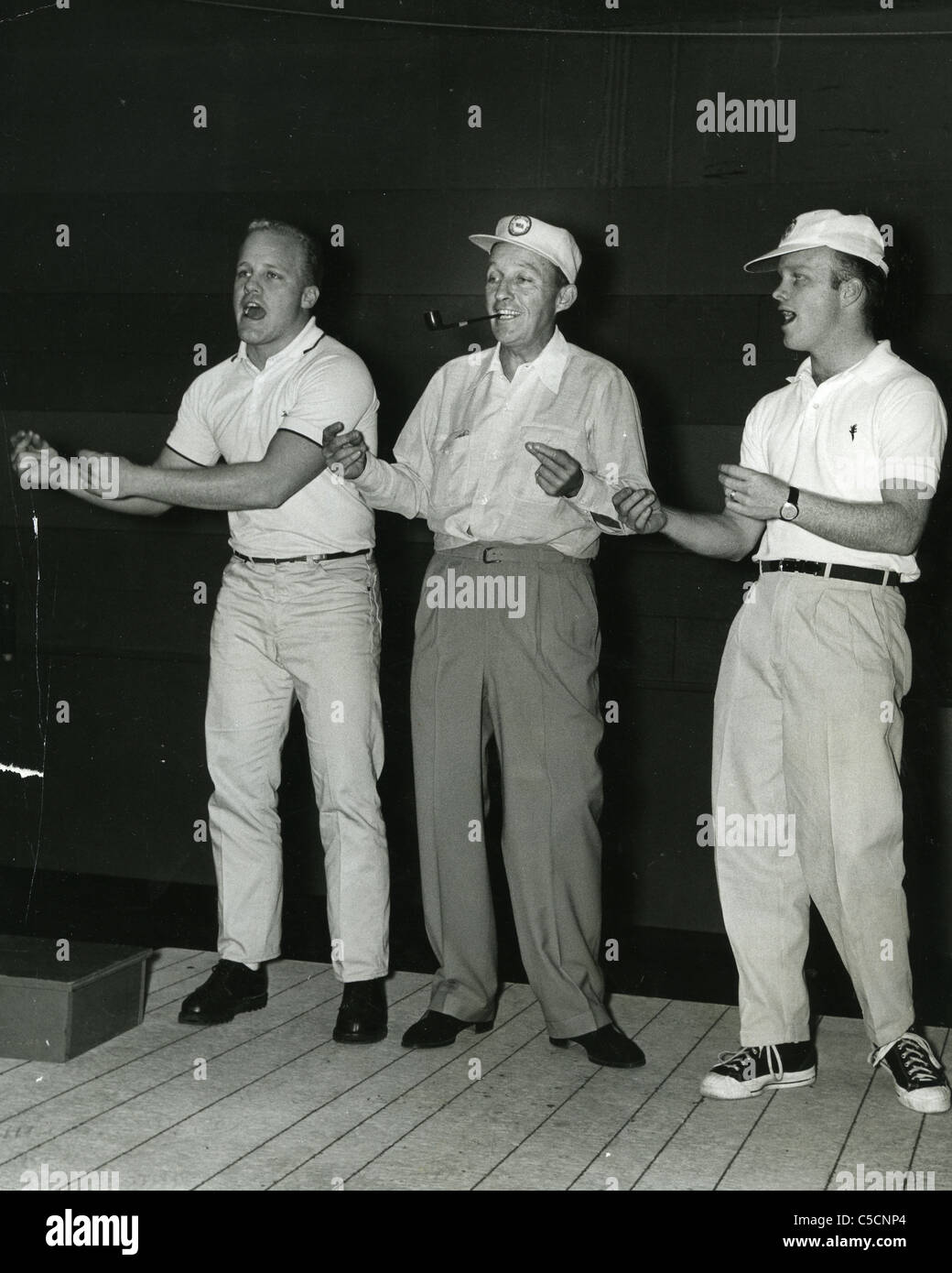 BING CROSBY reahersing routine with sons Dennis and Phillip for his TV show - Stock Image