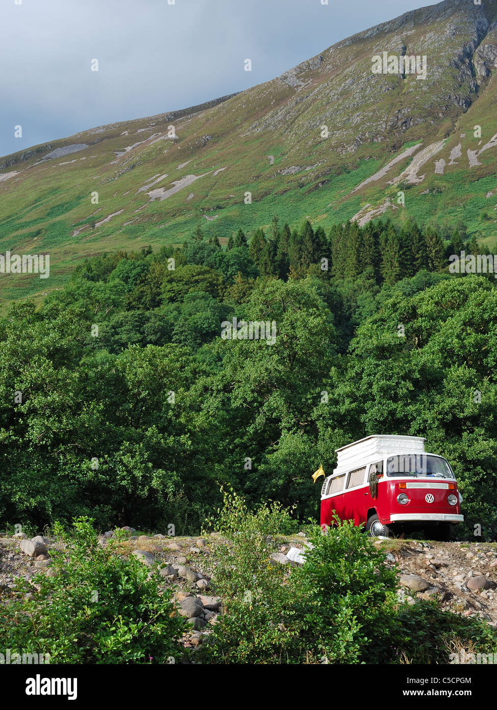 Touring the Highlands of Scotland in a VW campervan. - Stock Image