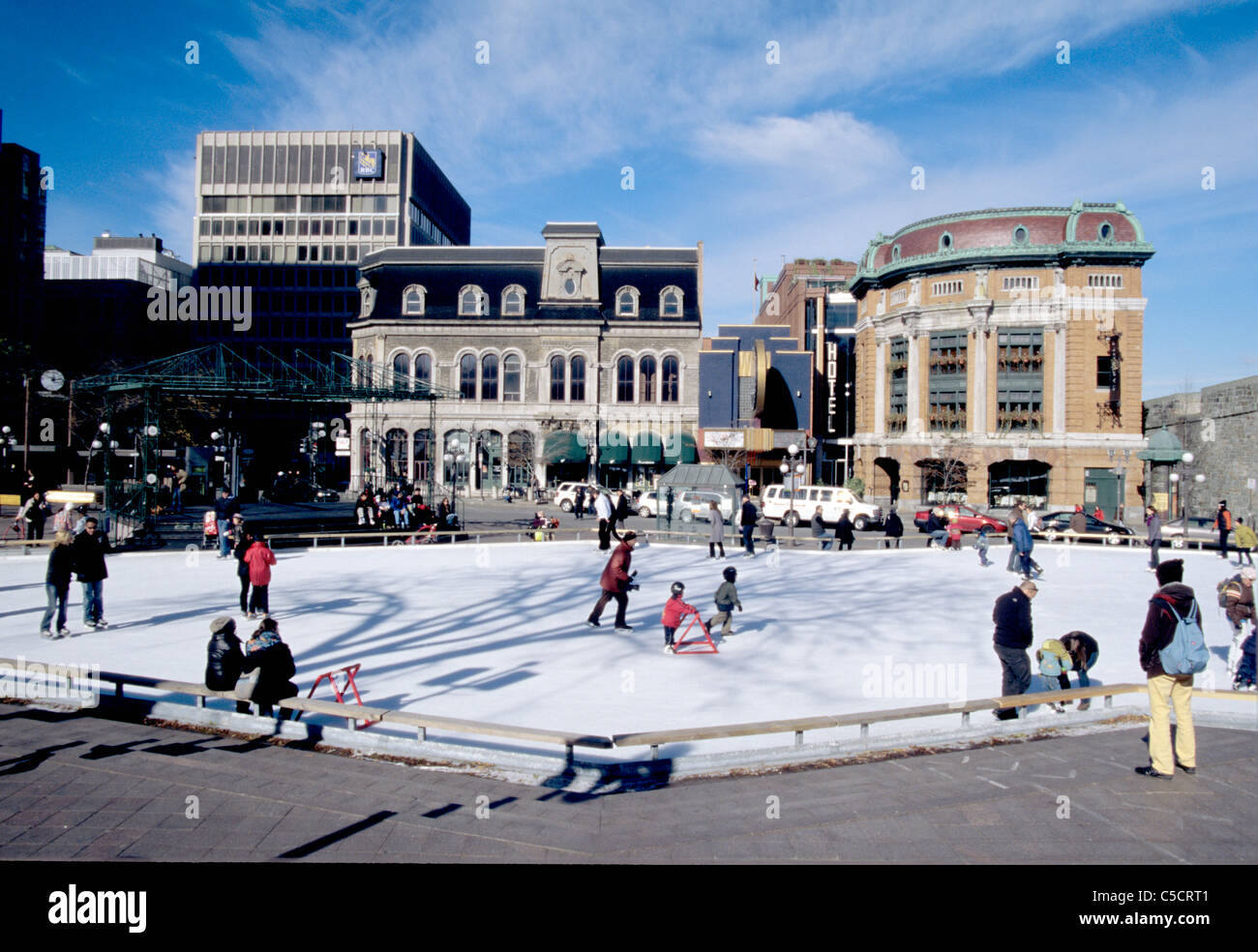 residents and tourists ice skate on public ice skating rink in Canada - Stock Image