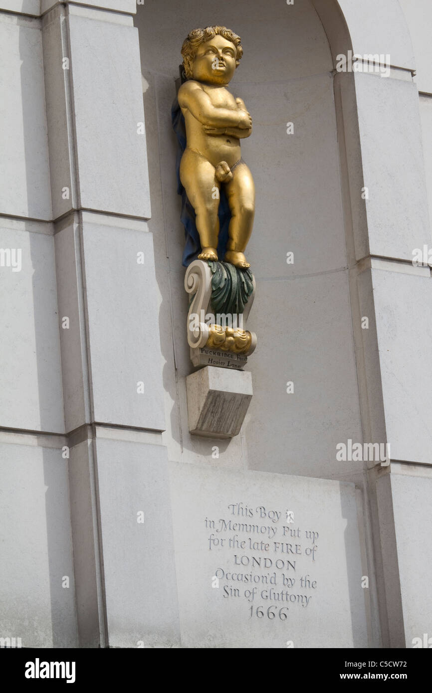 The golden boy of Pye corner supposed to mark where the great fire of london stopped and is a symbol of gluttony - Stock Image