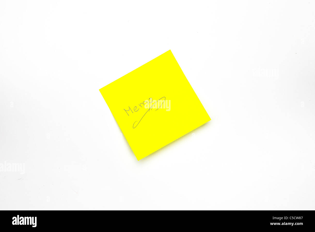 a yellow notepad with the word Memo - Stock Image