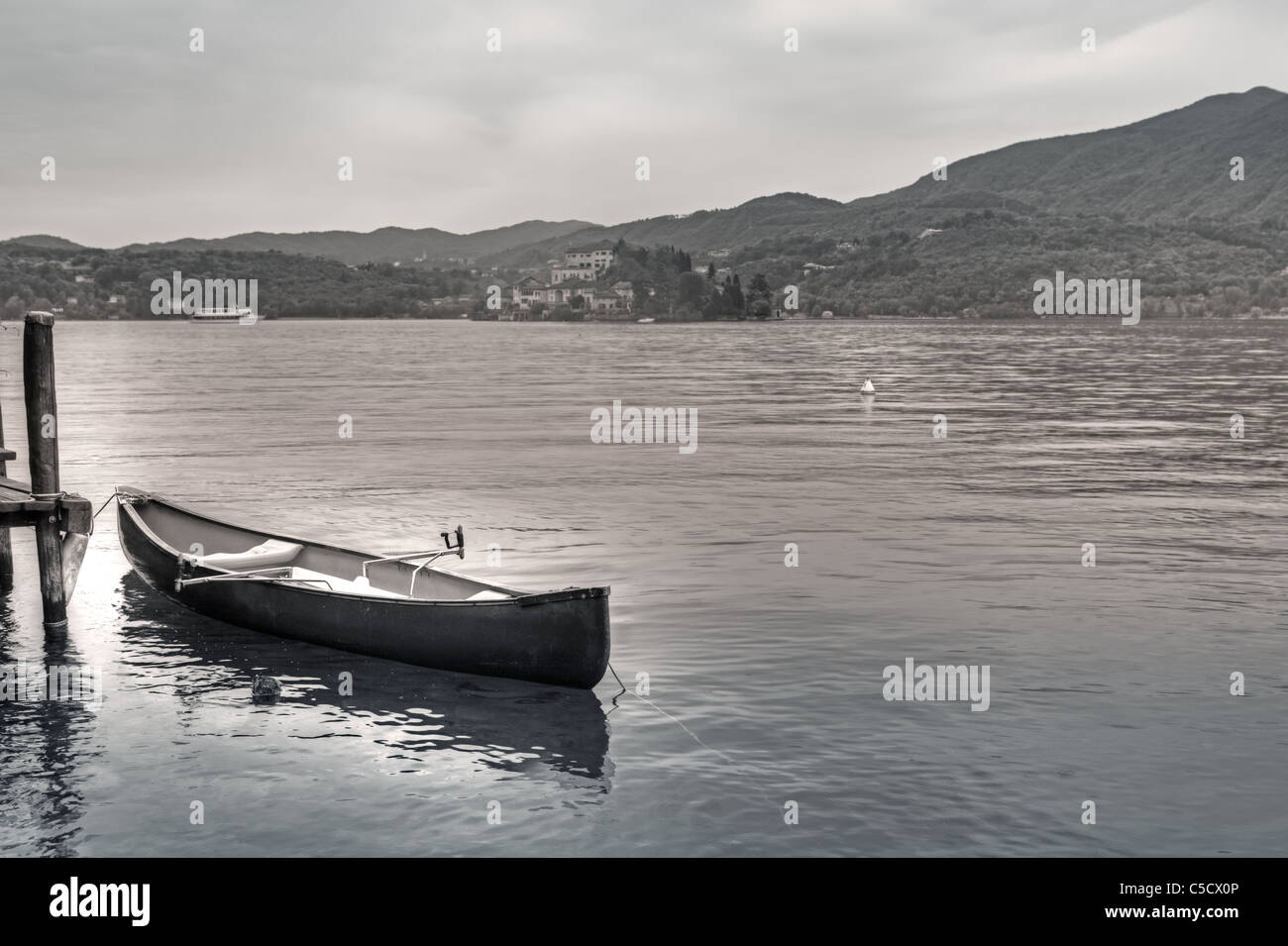 Photo retro look with a rowboat on Lake Orta and views of the island of San Giulio Stock Photo