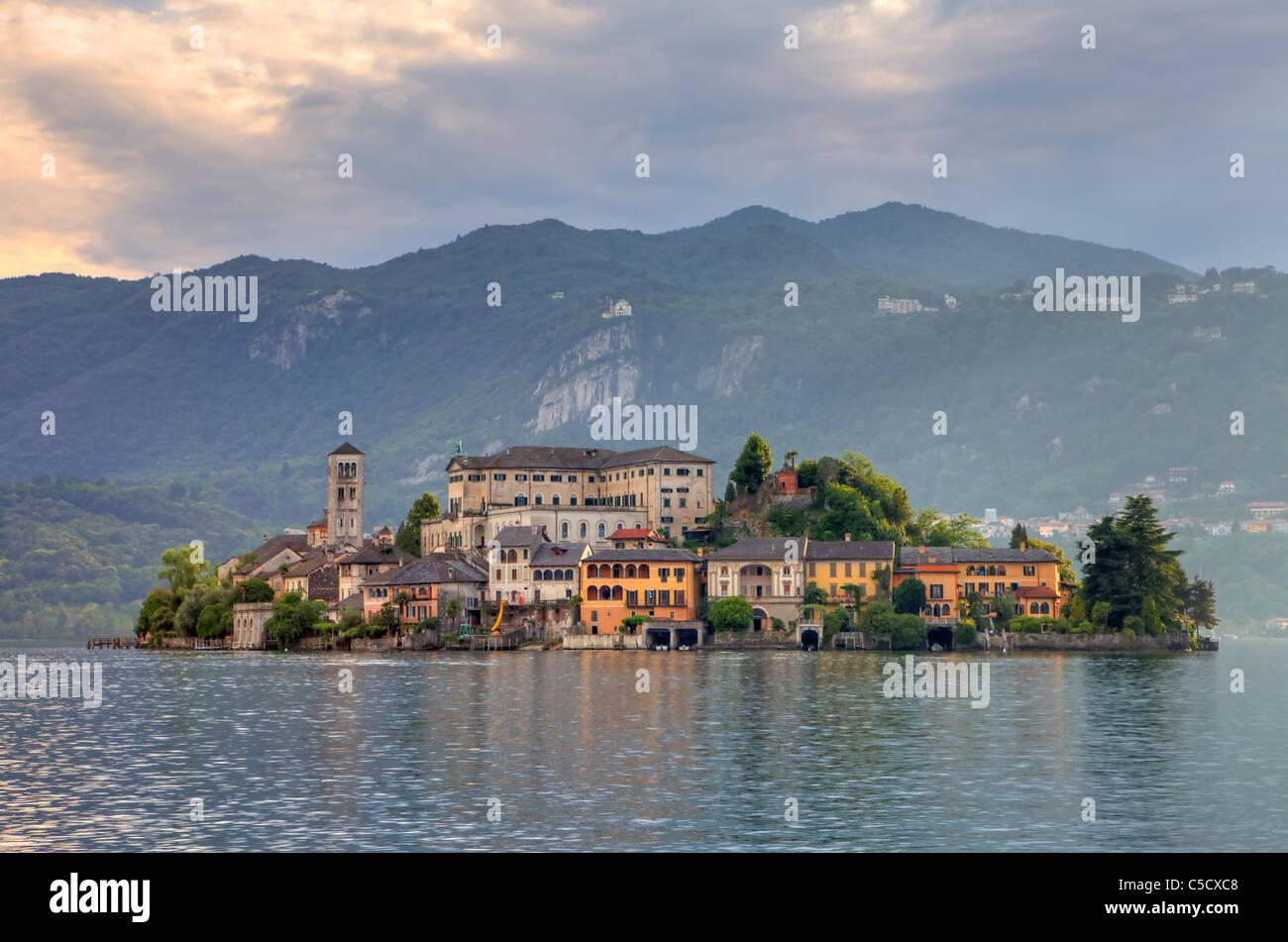 the island of San Giulio on Lake Orta in the evening sun Stock Photo